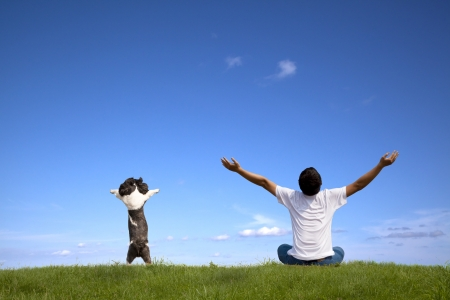 enjoy life: Young man with dog relaxed on summer times