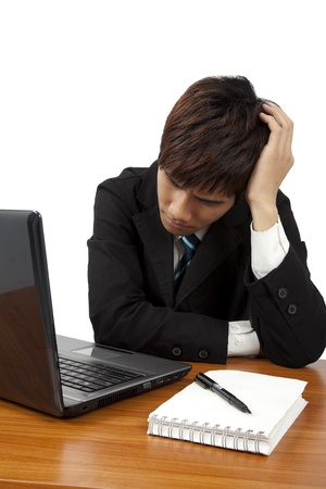 Young  business man having stress or a headache photo