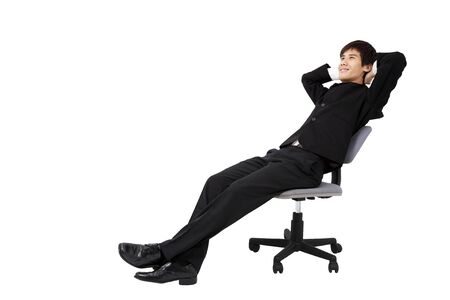employee satisfaction: Portrait of a relaxed young businessman sitting on the chair and isolated on white Stock Photo
