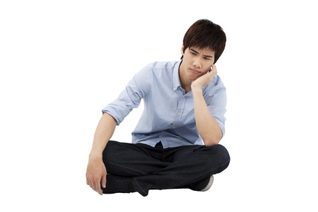 down sitting: upset young man sitting on the floor