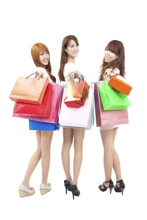 shoppers: three happy asian shopping woman Stock Photo