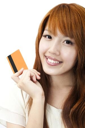Portrait of the beautiful happy girl  holding  a credit card for shopping Stock Photo - 9456109