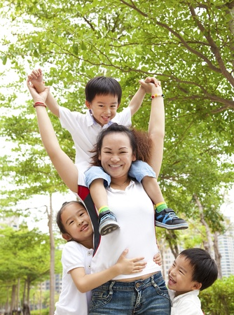 Happy Asian Mother with her daughter and son Stock Photo - 9456142