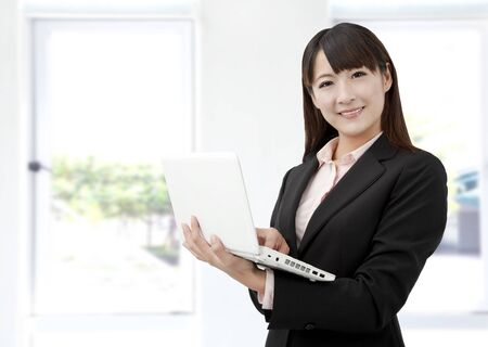 asian office lady: Young business woman with laptop in the office Stock Photo
