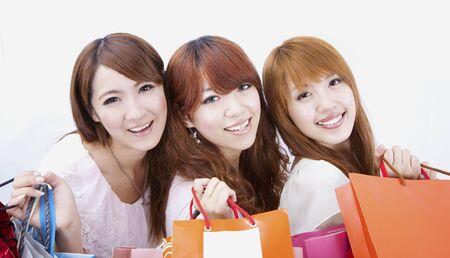 compras chica: tres ni�a feliz de compras Foto de archivo