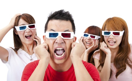 Surprised Young people in 3D glasses and watching a movie  photo
