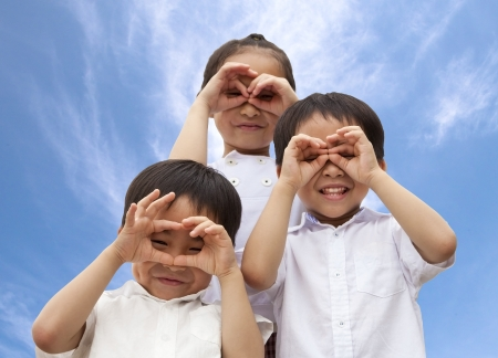 happy asian family: three asian kids