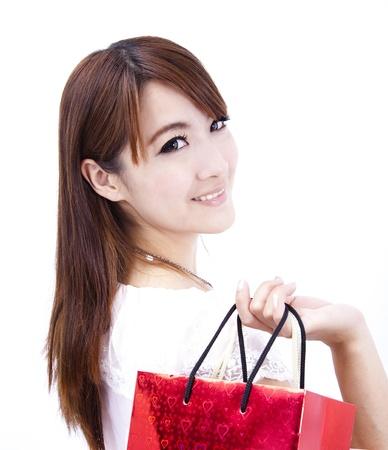chicas de compras: hermosa mujer asi�tica con bolsa de compras Foto de archivo