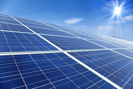 Closeup of Solar Panels with sunlight and blue sky background photo