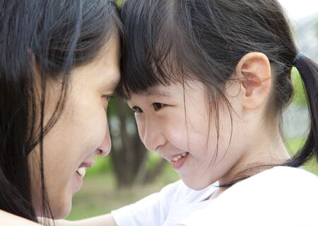 asian mother and daughter: Beautiful little girl looking her mother