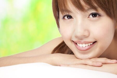Beautiful asian girl   with green background photo