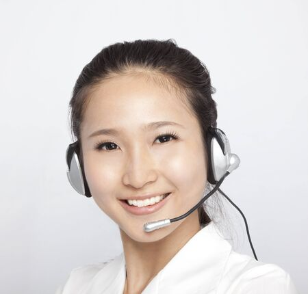 customer service representative: portrait of beautiful asian Customer Representative with headset Stock Photo