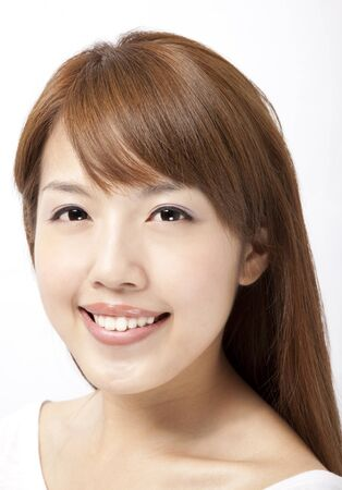Close up of asian young womans face with happy smile photo