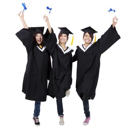 licenciatura: Grupo feliz de las ni�as de graduaci�n titulares de su diploma Foto de archivo