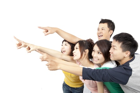 happy Asian young group pointing away isolated on white background Foto de archivo