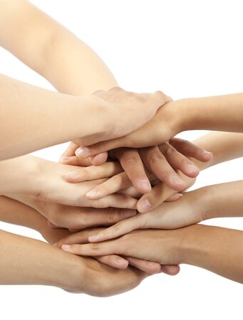 group of young peoples hands together photo