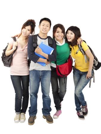 estudiantes universitarios: estudiantes asi�ticos felices aislados sobre fondo blanco Foto de archivo