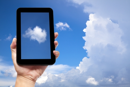 touchpad: hand holding tablet pc with cloud background