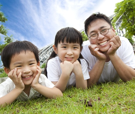bonding: happy family lying on the grass.father with son and daughter
