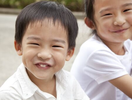 smiling asian boy and girl photo