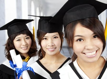 diplomas: happy graduation asian girls