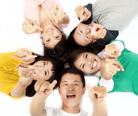 happy asian young group pointing at you  photo