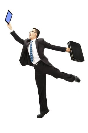 computer dancing: happy businessman holding tablet pc and Briefcase