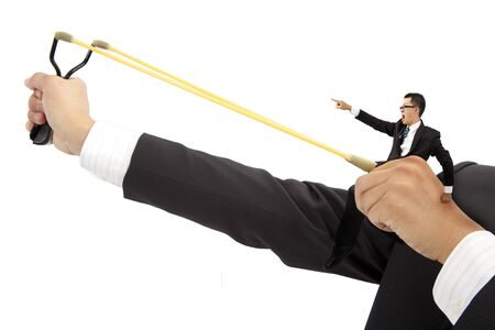 business motivate concept. businessman with slingshot and prelaunch photo