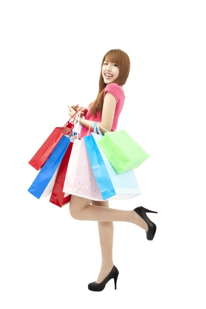 happy Beautiful woman with a lot of shopping bags photo