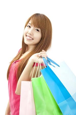 Aziatische mooie vrouw met boodschappentassen