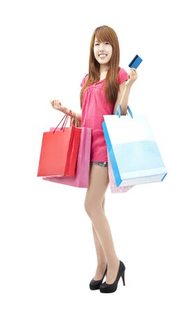 happy asian woman with shopping bags and credit card Stock Photo - 9999635