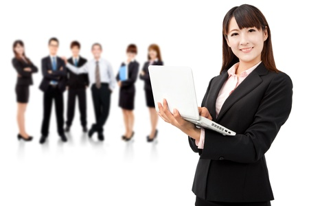 asian business women: smiling businesswoman holding laptop and successful business team
