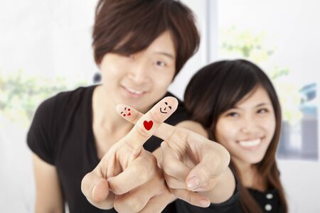 smiling fingers of happy couple photo