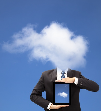 thinking cloud: businessman with cloud thinking concept and holding tablet pc