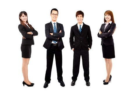 asian business team: young asian business team isolated on white background