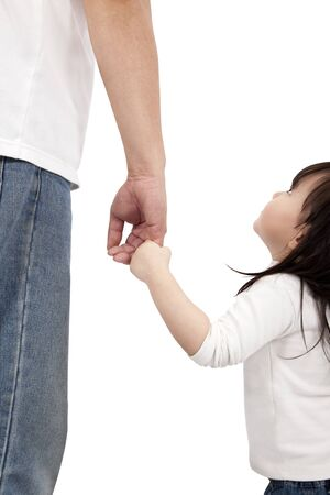 little girl looking her father and holding hand  photo
