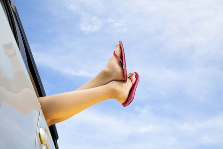 woman's: young womans legs and summer road trip concept