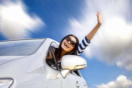woman driving: happy young woman in car driving on the road  Stock Photo