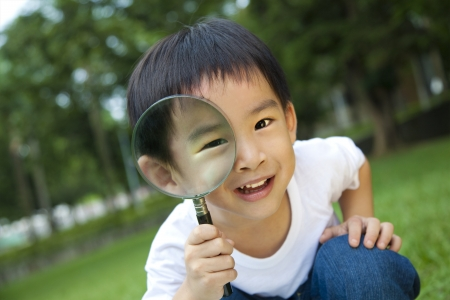 curious kid with magnifying glass