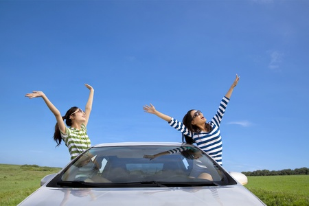 roadtrip: two happy woman  in the car and enjoy vacation Stock Photo
