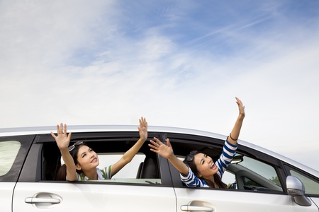 roadtrip: happy girls in the car and enjoy vacation
