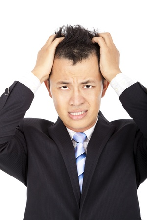 Stressed young asian businessman with headache on white photo