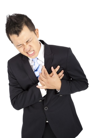 sudden: Young businessman having heart attack Stock Photo