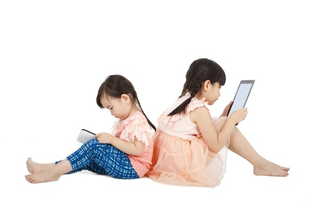 Two girls using touchscreen tablet PC  photo