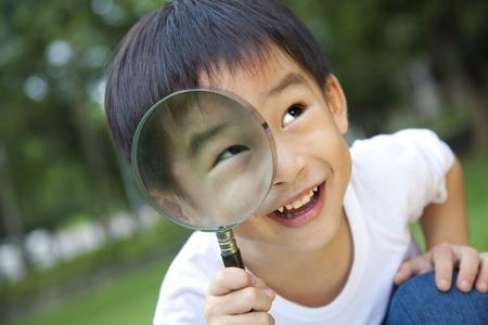 Ampliador de explotación chico asiático Foto de archivo