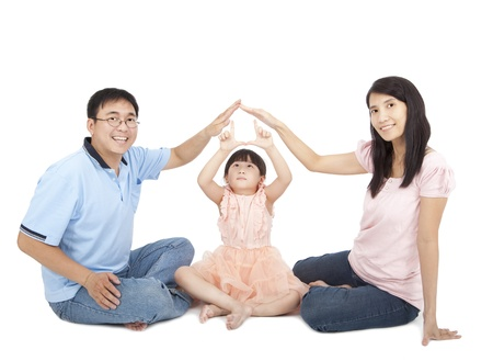 happy young family showing home sign by hands photo