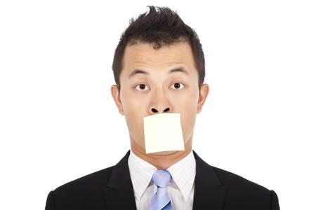 guardar silencio: hombre de negocios con el mensaje que Foto de archivo