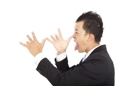 tonto: joven empresario riendo y haciendo frente a una persona Foto de archivo
