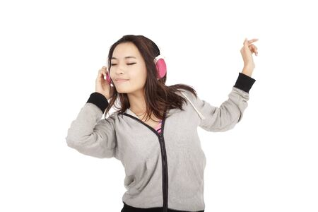 asian young woman listening to music and dancing Stock Photo - 10852761