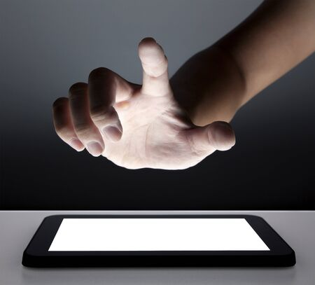 hand touching the touch screen of tablet pc